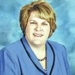 County schools promote two to central office